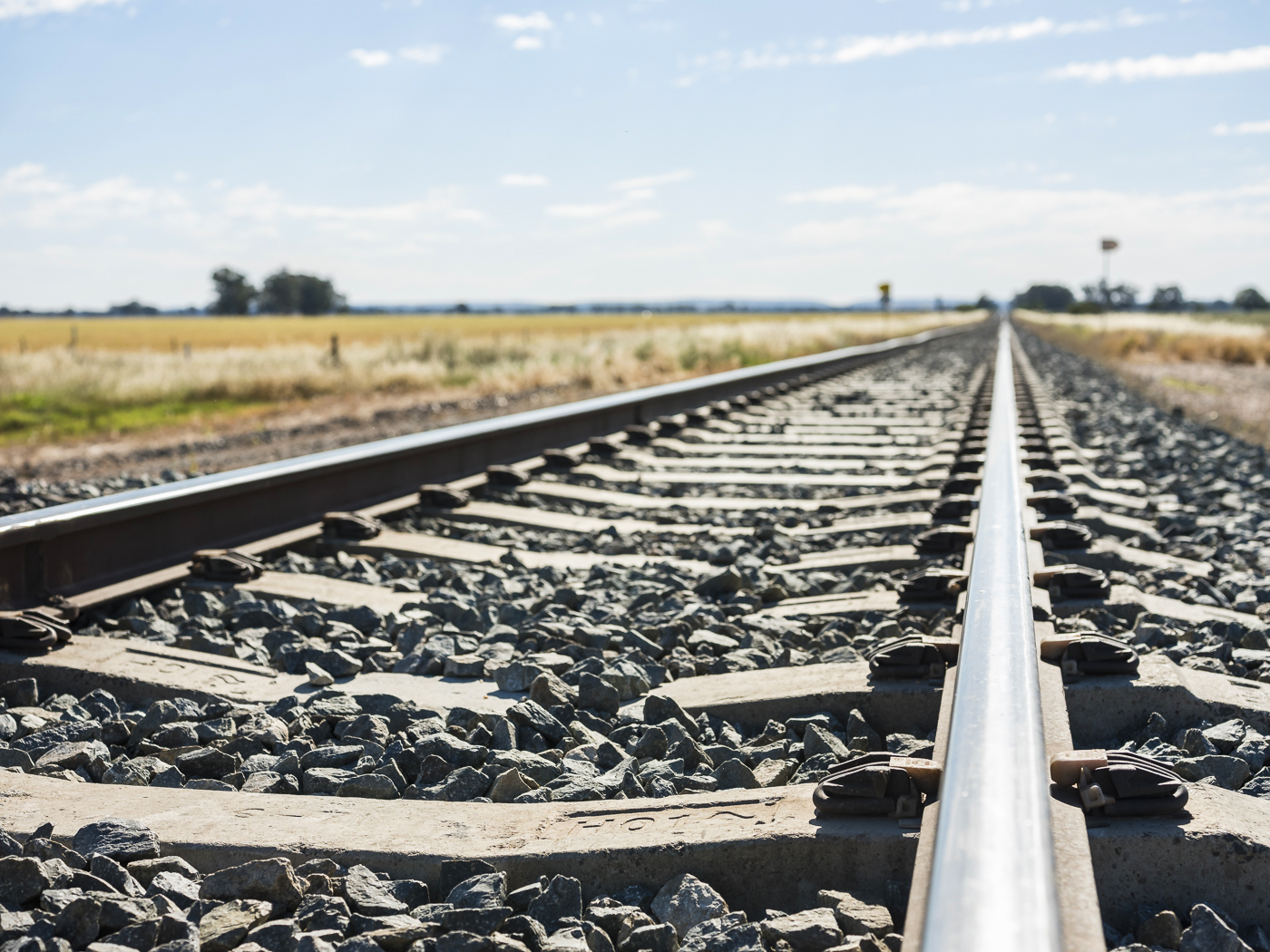 Close up of train tracks in a rural location, freight and logistics, transport, rail line, regional NSW